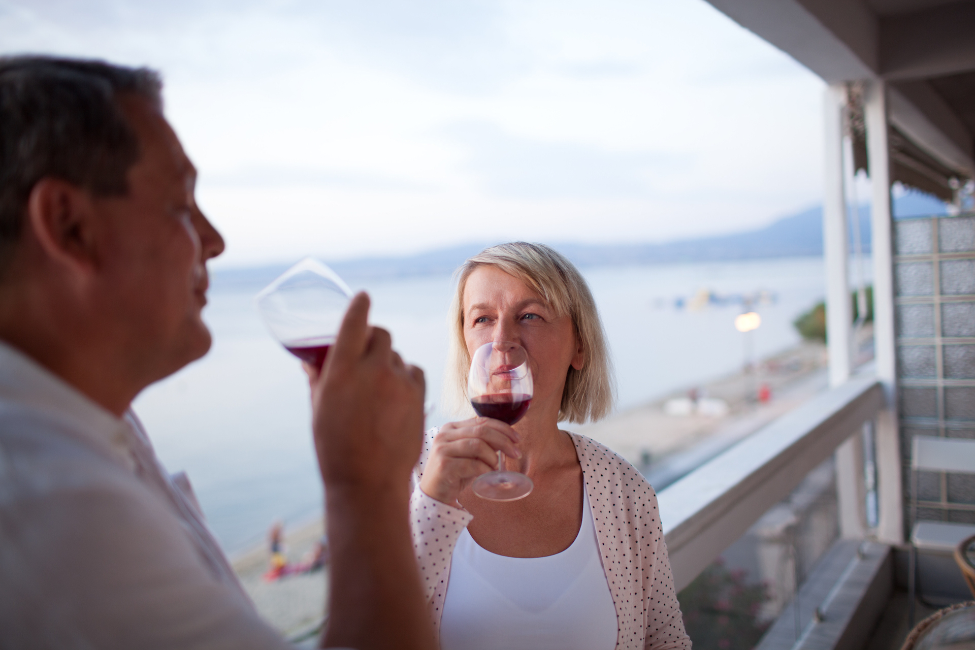 Couple drinking red wine on the balcony of their hotel on South Hutchinson Island